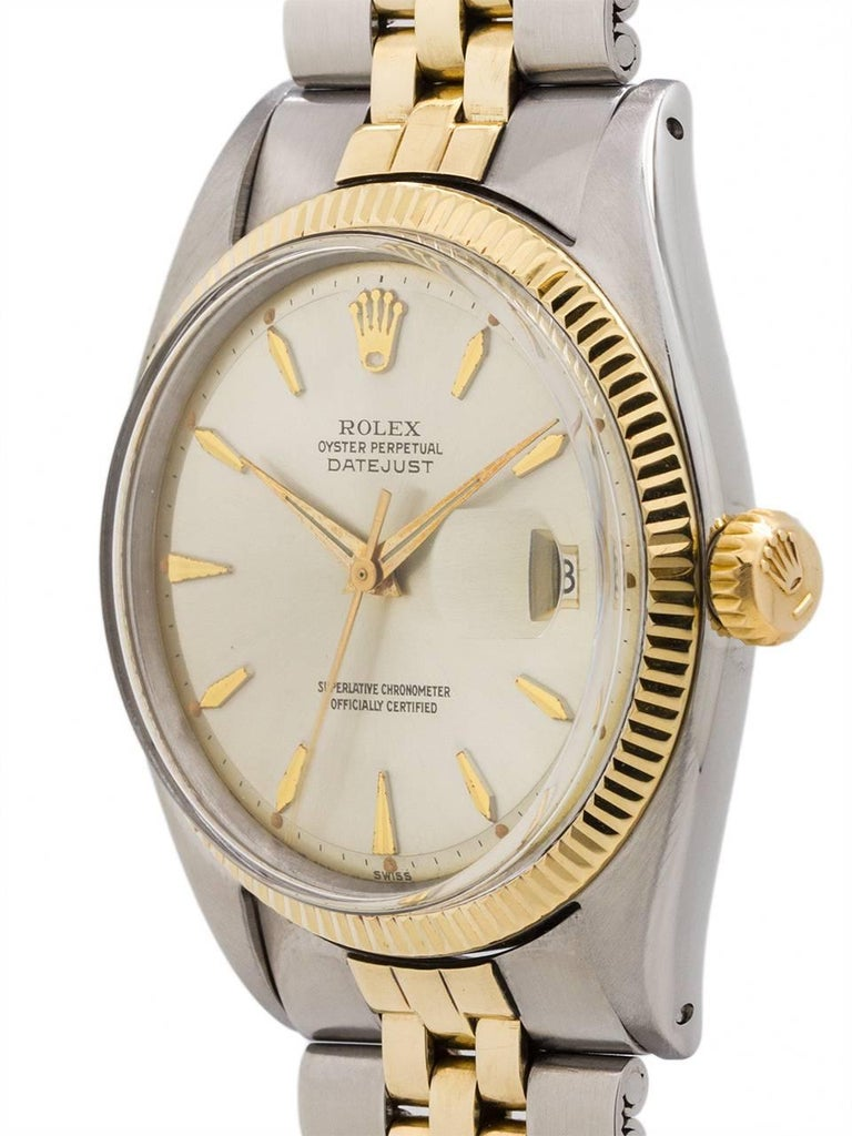 Rolex stainless steel and 14K yellow gold Oyster Perpetual Datejust ref 1601 serial number 631xxx circa 1960. Man's full size dress model 36mm diameter Oyster case with 14K yellow gold fluted bezel, signed screw down crown and acrylic crystal. With