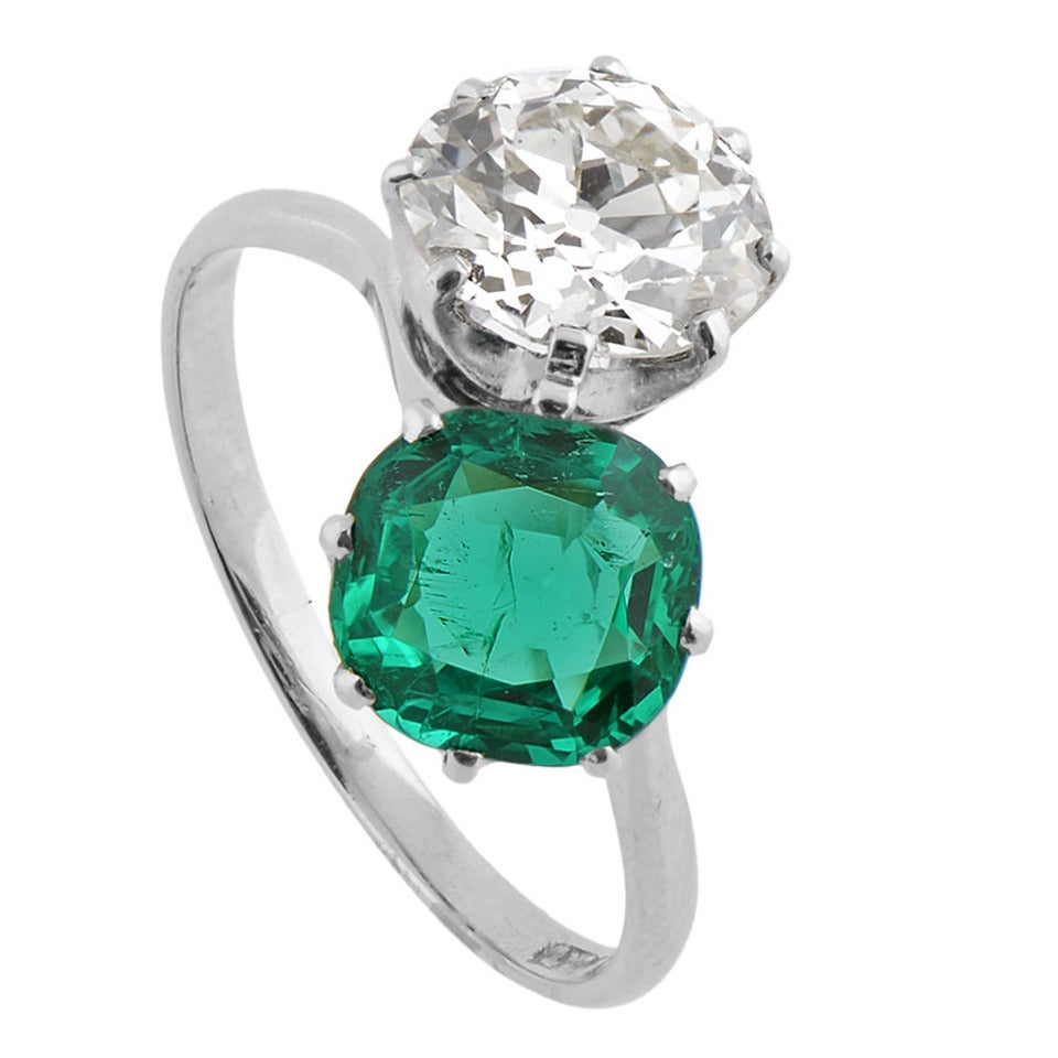 A Fine Two Stone Colombian Emerald Diamond Platinum Crossover Ring 1