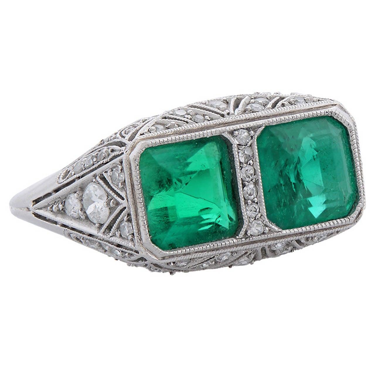 A Fine Art Deco Two-Stone Emerald Diamond Platinum Ring 1
