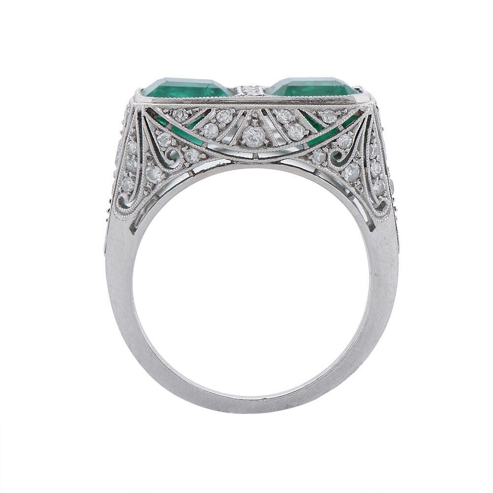 A Fine Art Deco Two-Stone Emerald Diamond Platinum Ring 4