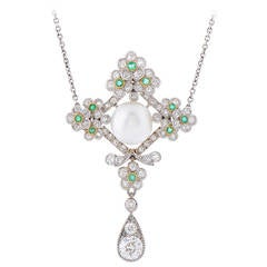 An Edwardian Natural Pearl Emerald Diamond Platinum Pendant