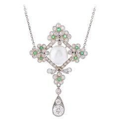 An Edwardian Natural Pearl Emerald Diamond Platinum Pendant