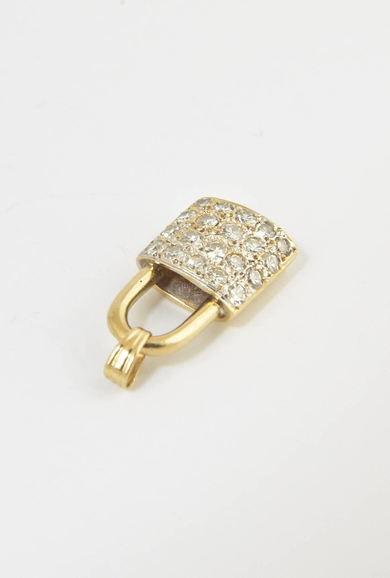Pavé diamond lock charm pendant made of 14K yellow gold