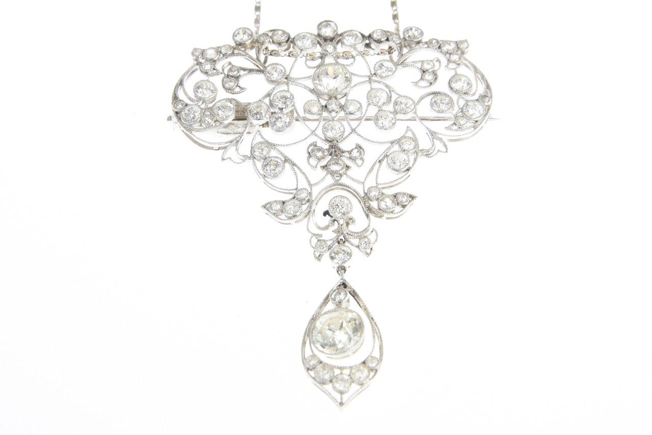 Exquisite Diamond Platinum Belle Époque Brooch, featuring a magnificent free formed organic design, which at one time was quite the fashion statement when sewn onto Her Majesty's Royal evening ballgowns.  Staying pure to its classic Belle Epoque