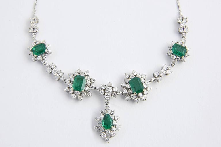 Glamorous 1950s emerald and diamond necklace featuring 5 brilliant Zambian Emeralds surrounded by approximately 5 carats of beautiful diamonds.  