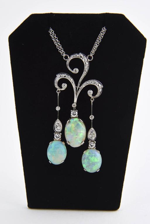 Early 20th Century opal and diamond 14k white gold negligee necklace featuring fine quality gray crystal opal and diamonds.