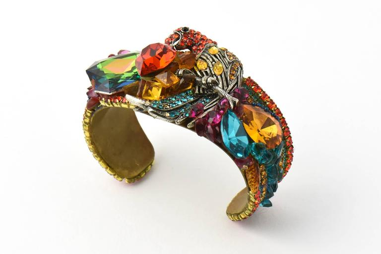 Impressive Wendy Gell Cuff Bracelet handmade by Gell in 1981.  This bold, colorful, and gorgeous bracelet features a parrot, paved with colorful Swarovski stones, accented with larger and smaller rhinestone which include a red heart and a large