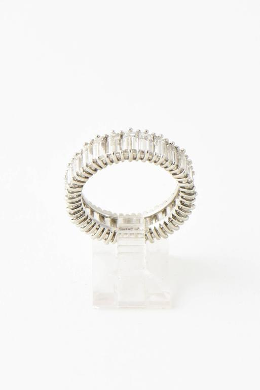 Mid-20th Century 5 Carat Emerald Cut Diamond Platinum Eternity Band Ring In Excellent Condition For Sale In Miami Beach, FL