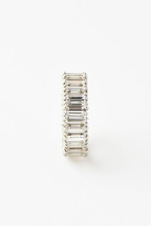 Mid-20th Century 5 Carat Emerald Cut Diamond Platinum Eternity Band Ring For Sale 4