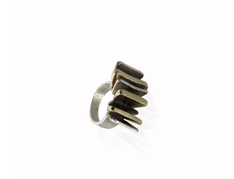 Mid-Century Modern Brutalist-style ring with sterling silver band featuring alternating rows of sterling silver and 14K yellow gold. US ring size: 5.5; sizable.
