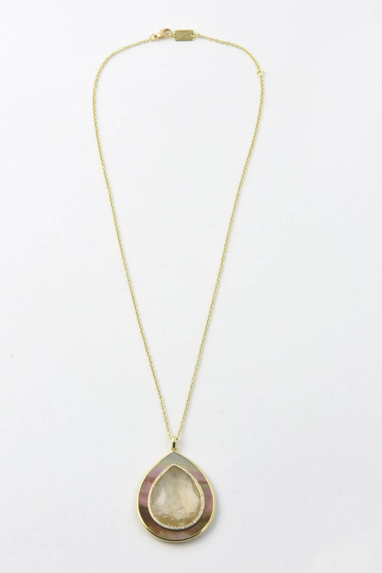 Ippolita 18K Ondine Teardrop Necklace. 18K yellow gold chain-link necklace featuring bezel set diamond embellished rutilated quartz drop pendant with shell accent and spring ring closure.