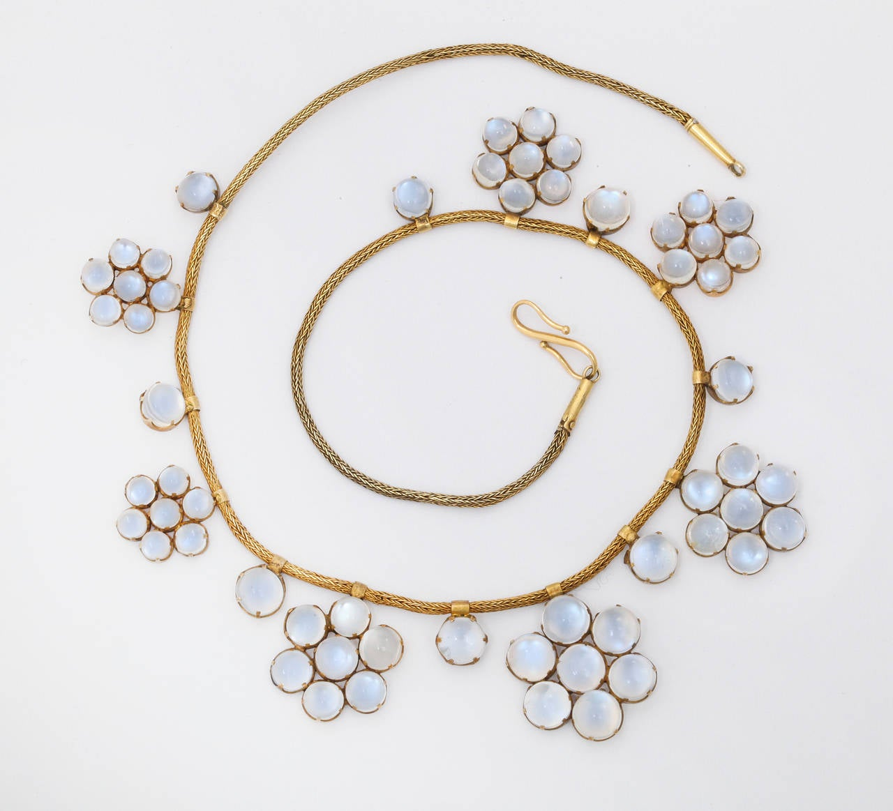 This wonderful necklace is an extraordinary example of delicacy and superior workmanship.  Each of the 57 cabochon moonstones has been expertly set and attached to the necklace- seeming to float weightlessly over the neckline.  Finding such a