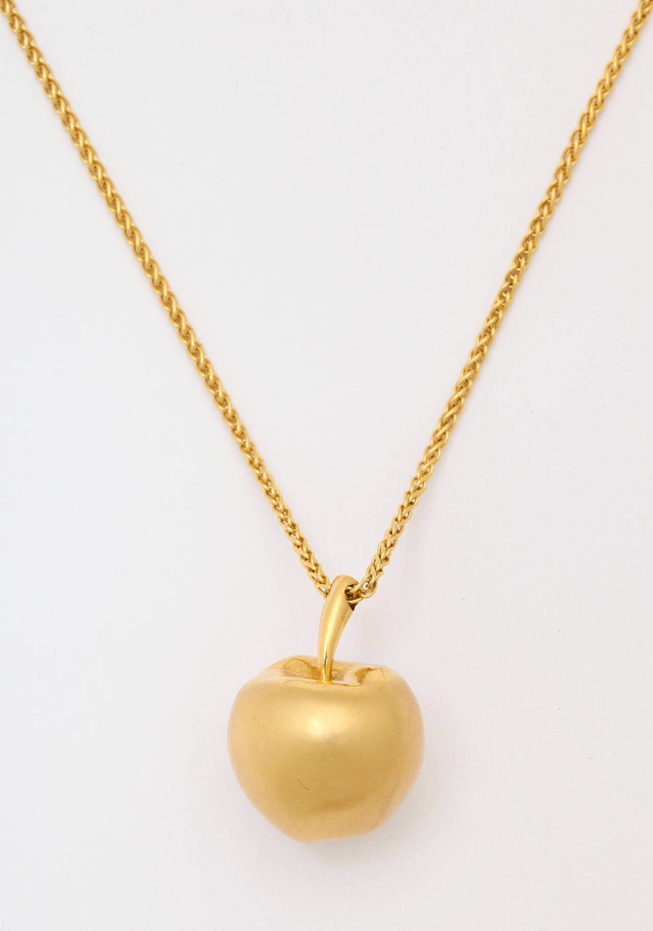 Long gold chain with apple pendant at 1stdibs the beautiful matte solid gold apple pendant is suspended from a 295 inch woven mozeypictures Choice Image