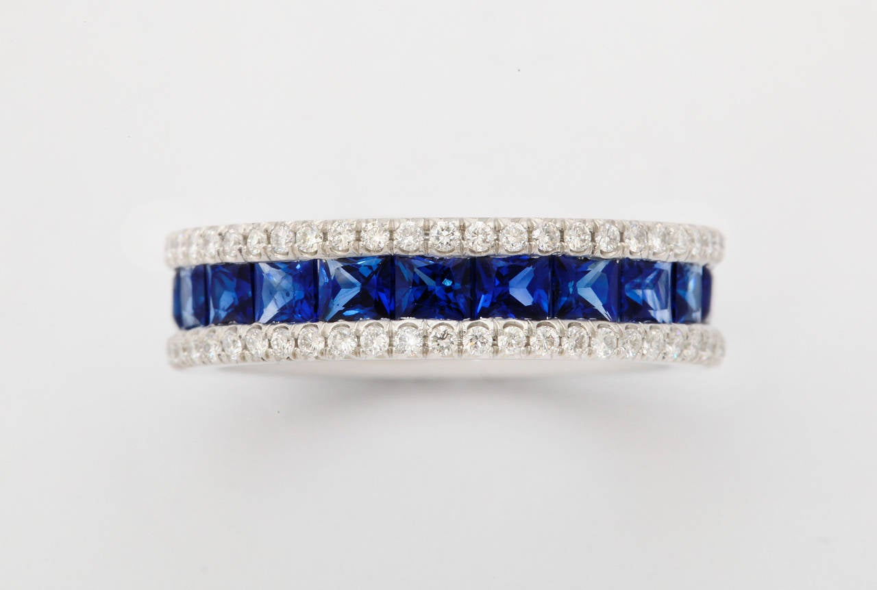 Very finely made platinum, square sapphire and round diamond eternity band ring.  Presently size 5 3/4.  The ring can be adjusted to fit from size 5 to 6.