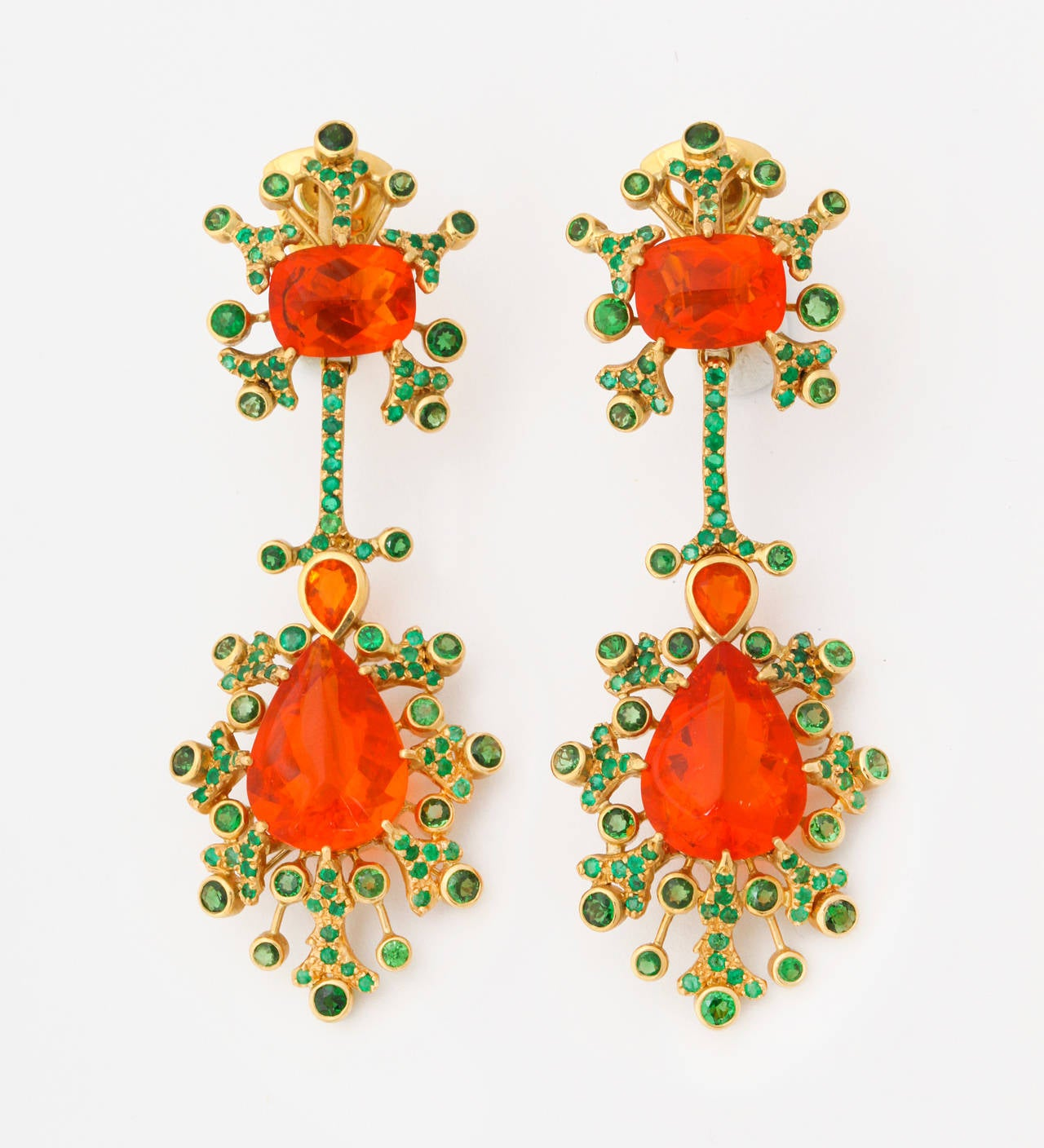 """Marilyn Cooperman """"Hot Pepper Fire Opal"""" earclips set with Mexican fire opals (25.71cts) and tsavorite garnets.  Marilyn Cooperman is an exclusive, New York based designer, who is well known amongst true jewelry connoisseurs.  Formerly the head"""