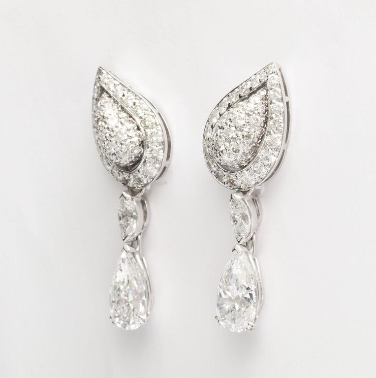 18kt white gold and diamond earclips, by Cartier made in France.