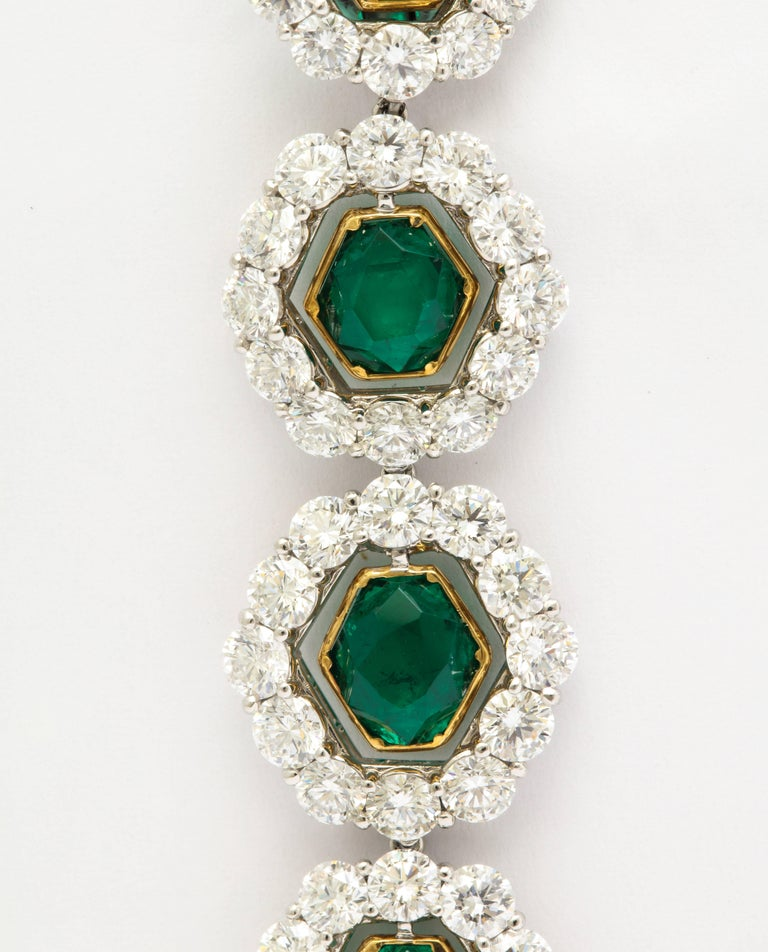 Rarely seen cutting, and superior quality, is what makes these truly unique earclips absolutely one of a kind.  The 8 Colombian emeralds (total weight 15.61cts and all certified by the prestigious Swiss laboratory Gubelin) are cut into hexagons.