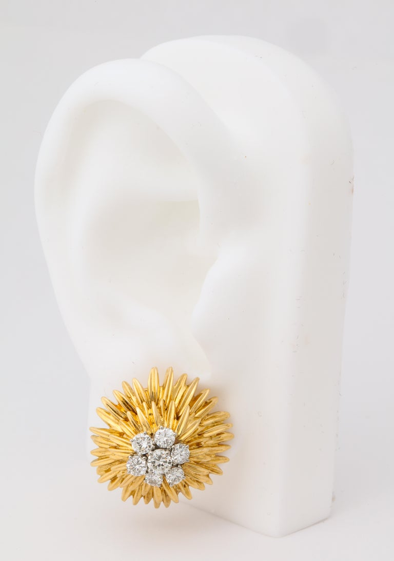 Wonderfully three dimensional layered gold with a central diamond cluster, these earrings perfectly represent VCA's work in Paris during the 1960's.  They will sit perfectly on the ear, as they are made with a distinct right and left and feature