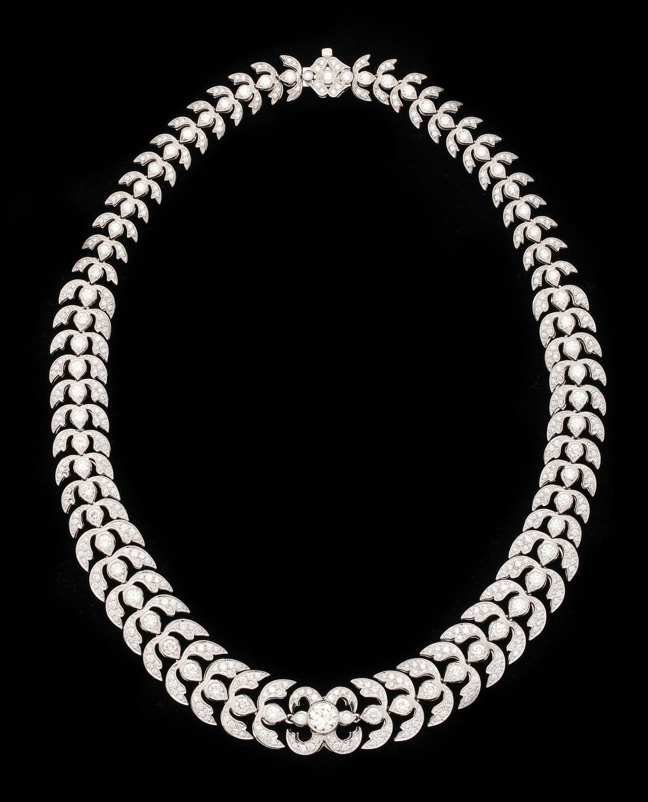 This wonderfully flexible necklace will sit perfectly on the neck thanks to the superior craftsmanship.  In total there are almost 16cts of fine, white diamonds and the center round brilliant weights app. 1.25cts.  Mounted in platinum.  16.5 inches
