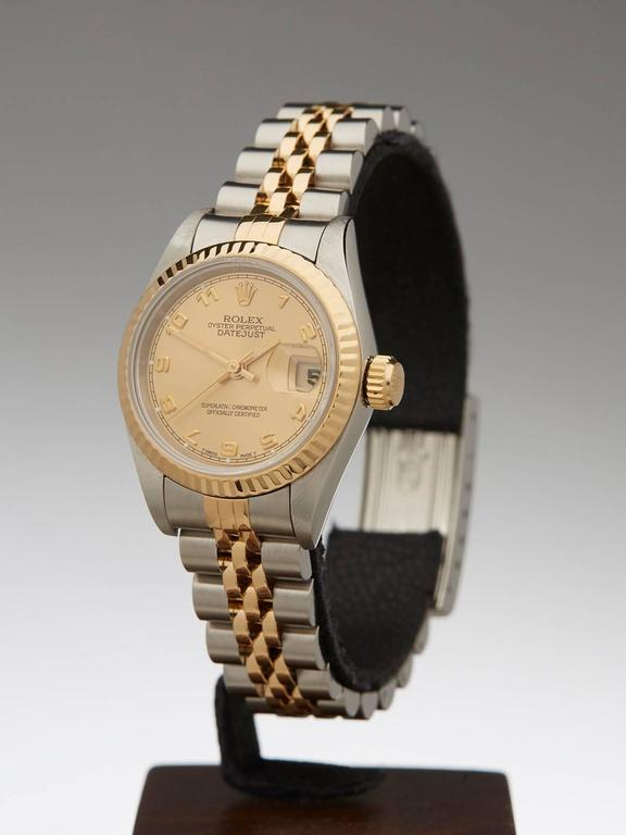 Ref 	COM561 Model Number 	69173 Serial Number 	W84**** Condition 	9 - Excellent condition Gender 	Ladies Age 	1995 Case Diameter 	26 mm Case Size 	26mm Box & Papers 	Xupes Presentation Pouch Movement 	Automatic Case 	Stainless Steel/18k Yellow
