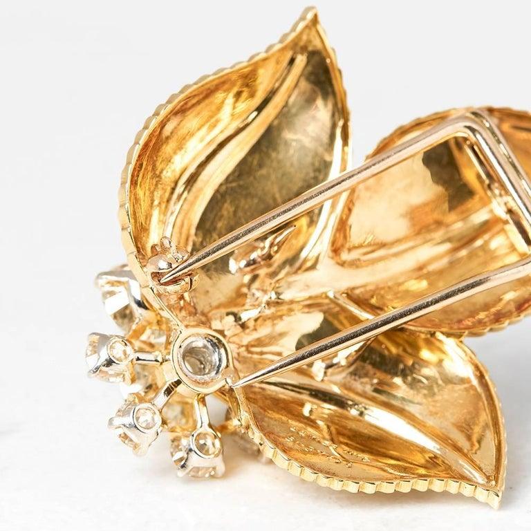 Round Cut Cartier 18 Karat Yellow Gold Diamond Three Leaf Vintage Brooch For Sale