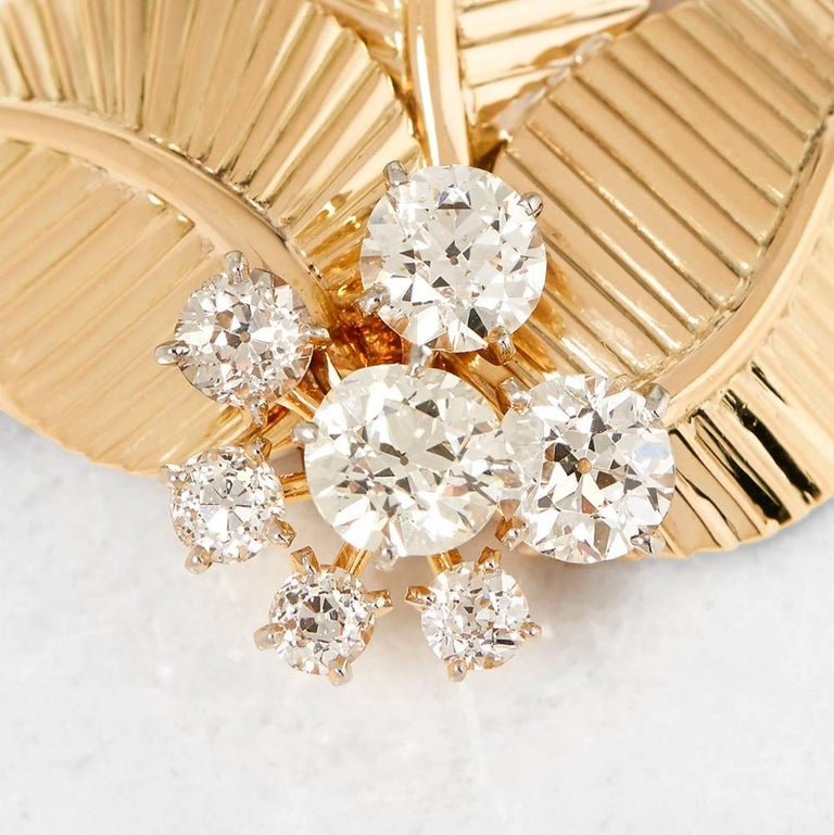 Code: COM1173 Brand: Cartier Description: 18k Yellow Gold Three Leaf Diamond Vintage Brooch Accompanied With: Presentation Box Gender: Ladies Brooch Length: 4.5cm Brooch Width: 3.7cm Condition: 8 Material: Yellow Gold Total Weight: 18.38g