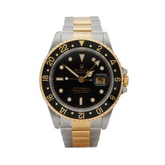 Rolex GMT-Master II Stainless Steel and 18 Karat Yellow Gold 16713LN