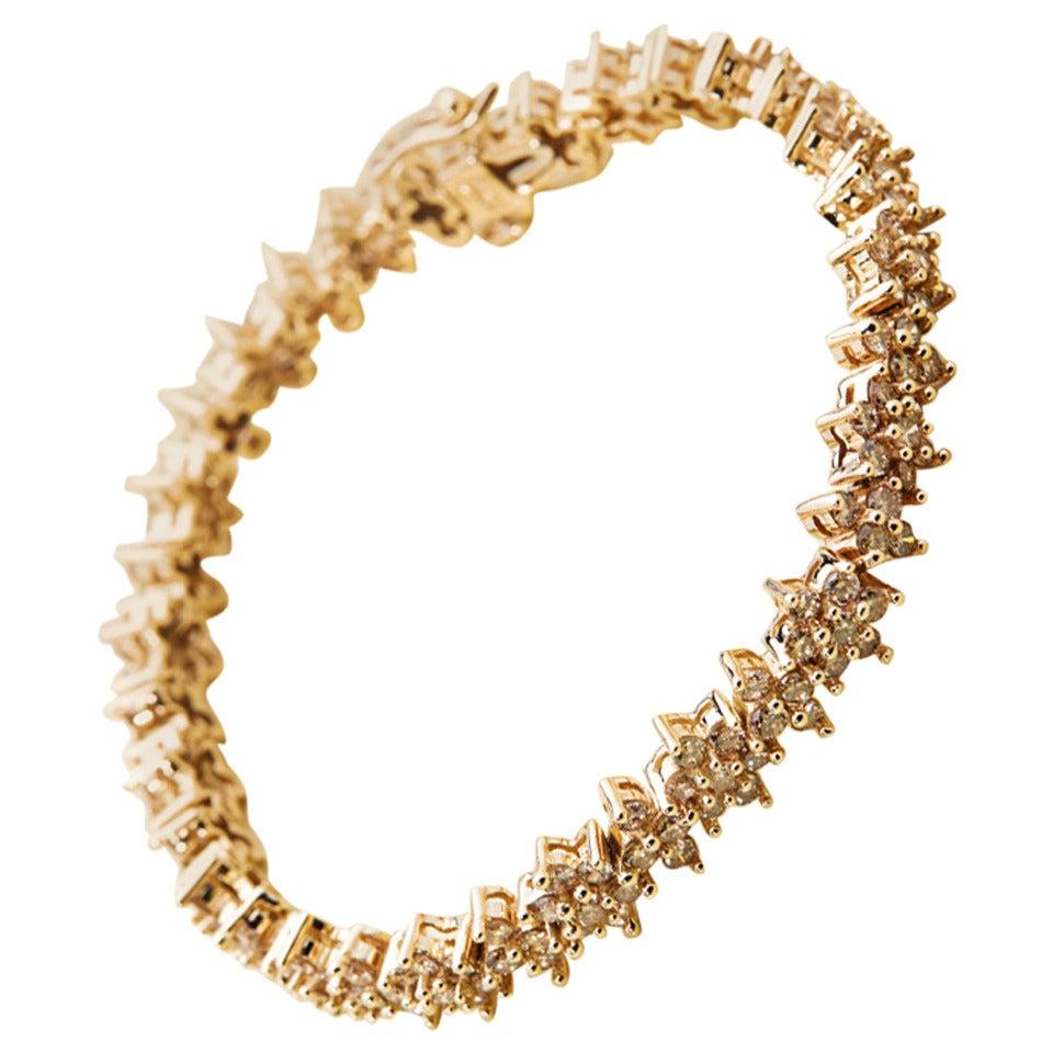 Fancy Yellow Diamond Gold Flower Tennis Bracelet For Sale