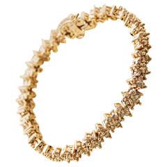 Fancy Yellow Diamond Gold Flower Tennis Bracelet