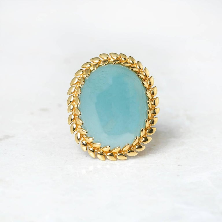 Code: J331 Brand: Carla Amorim Description: 18k Yellow Gold Cabochon Aquamarine Ring Accompanied With: Presentation Box Gender: Ladies UK Ring Size: N EU Ring Size: 54 US Ring Size: 7 Resizing Possible?: NO Band Width: 5mm Condition: 8 Material: