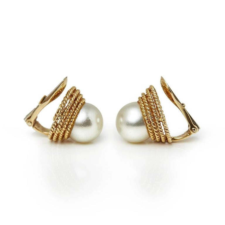 Ref:	COM1313 Size:	 Earring Length - 1.5cm, Earring Width - 1.5cm Box & Papers: Xupes Presentation Box Material: 18k Yellow Gold, total weight - 7.94 grams Gemset: Set with 2 Cultured Pearls measuring 9mm each Condition: 9 - Excellent
