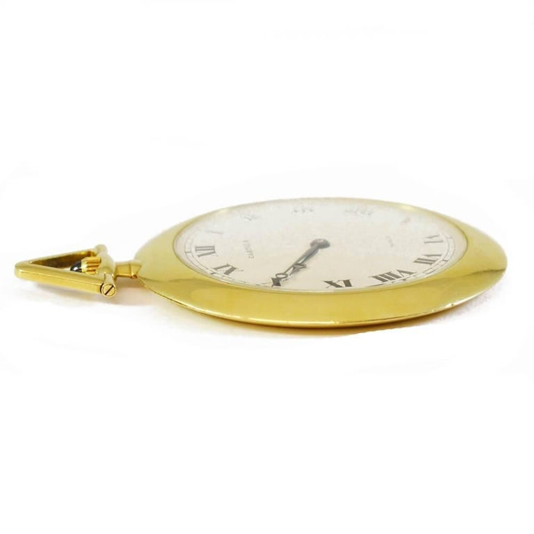 Classic Cartier gold pocket watch with black Roman numerals on a white face. 18ct yellow gold case. French, circa 1970.