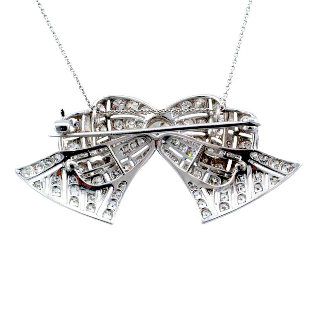 Art Deco Diamond Platinum Bow Brooch Pendant In Excellent Condition For Sale In Los Angeles, CA
