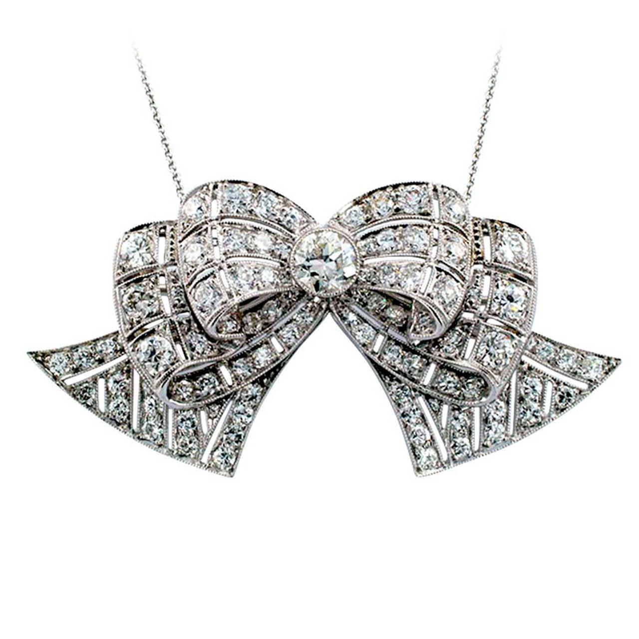 Art Deco Diamond Platinum Bow Brooch Pendant For Sale