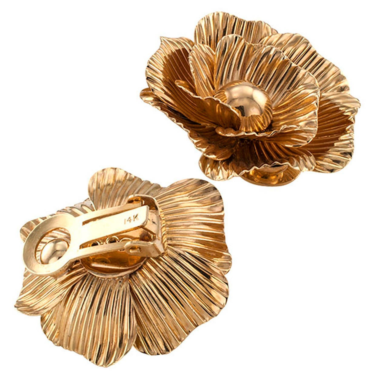 Three dimensional and sculptural, these late retro designs, circa 1950, representing fully open camellia flowers with delicate and graceful hand tooled petals will surely bring pleasure in wearing and pride of ownership to any woman who fancies the