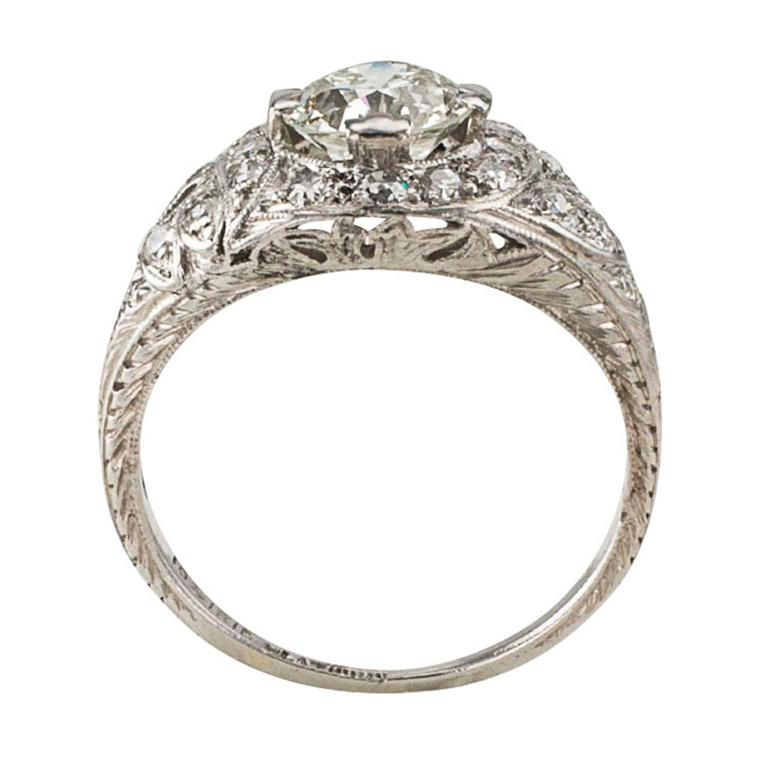 1.03 Carats G VVS2 Art Deco Engagement Ring  The enthusiastically pretty and original Art Deco engagement ring showcases an old European-cut diamond weighing 1.03 carats, accompanied by a report from EGL-USA stating that the diamond is G color and