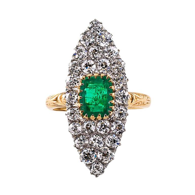 Edwardian Emerald and Diamond Ring  So much exhilaration and happiness contained in the simple navette shaped design as old diamonds shimmer and cuddle tightly around the old emerald cut Emerald displaying its beautiful color as it rests within