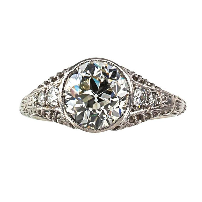 1.84 Carats Edwardian Diamond Engagement Ring  Edwardian masterpiece, distinctive and gorgeous, showcasing an old European-cut diamond weighing 1.84 carats, accompanied by a GIA report stating that the diamond is K color and VS2 clarity, between