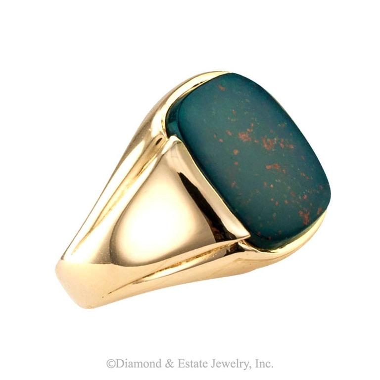 1940s Bloodstone Gentleman's Ring  A classic gentleman's ring featuring a fine bloostone specimen with an abundance of pronounced reddish markings, a very desirable quality.  Bloodstone is a form of chalcedony.  On the internet, there is a