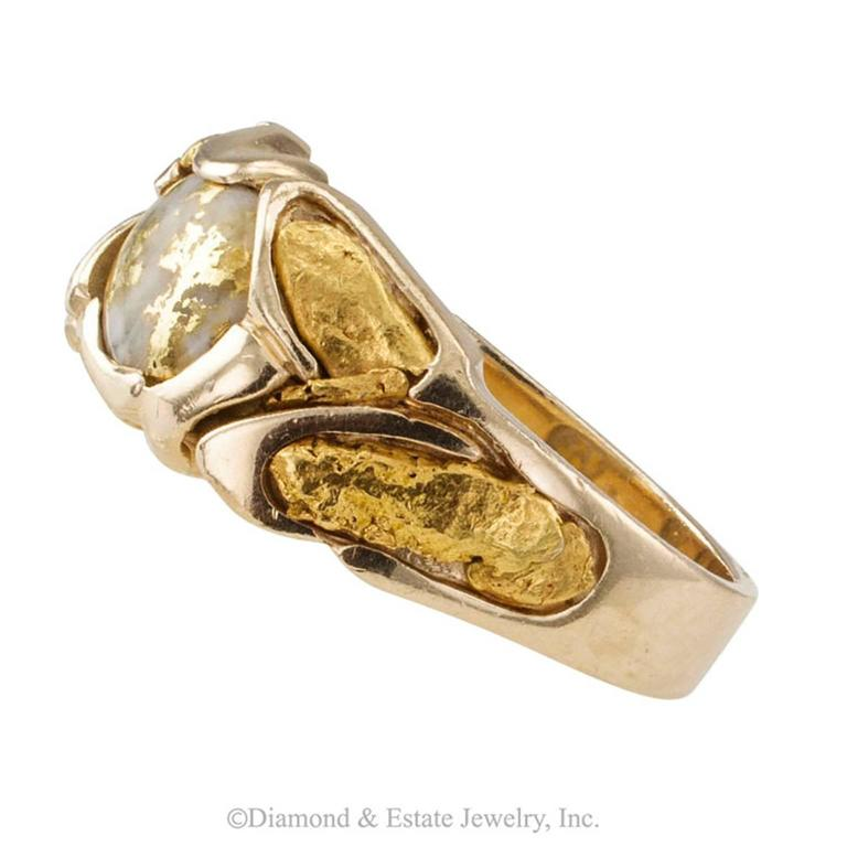 Gold Quartz and Gold Nugget Estate Ring  A mans estate gold quartz and gold nugget ring, mounted in 14-karat gold.  If pure gold as it comes right out of the earth is your thing, then... Eureka!  A gentlemen's ring that is unique and different, no
