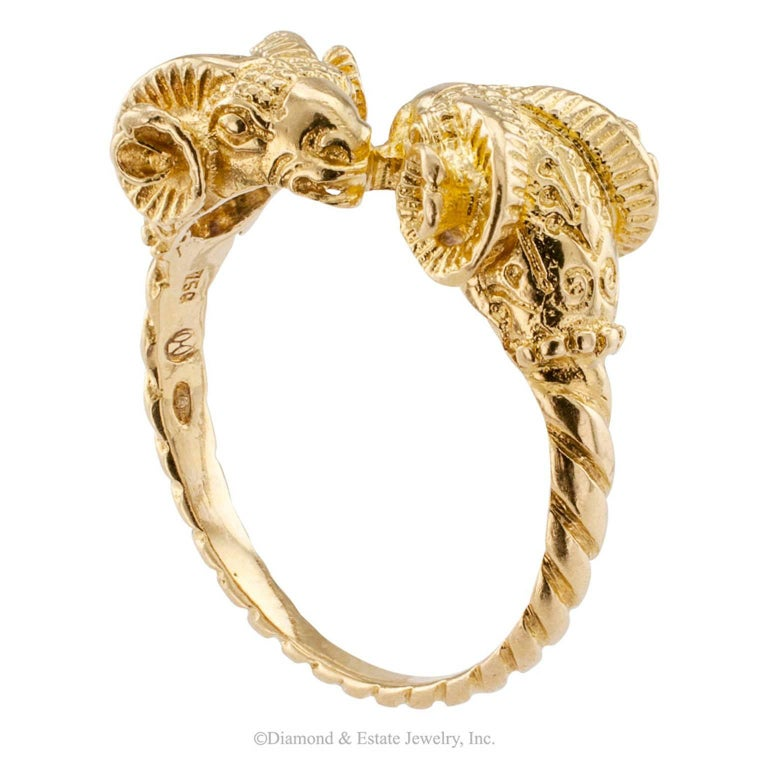Lalaounis 1980s Twin Ram Heads Ring Gold  Lalaounis 1980s twin ram head ring.  This petite version featuring the iconic twim ram head motif is down right cute, crafted in 18-karat yellow gold with maker's marks for Ilaias Lalaounis.   RING SIZE:  6