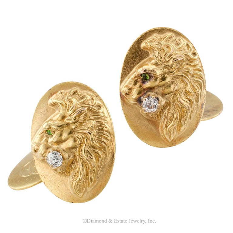 Art Nouveau Demantoid Garnet Diamond Gold Cuff Links  Art Nouveau demantoid garnet and diamond lion head gold cuff links circa 1905.  The front faces depicting in relief the profile of a male lion, the eye set with a faceted demantoid garnet and a