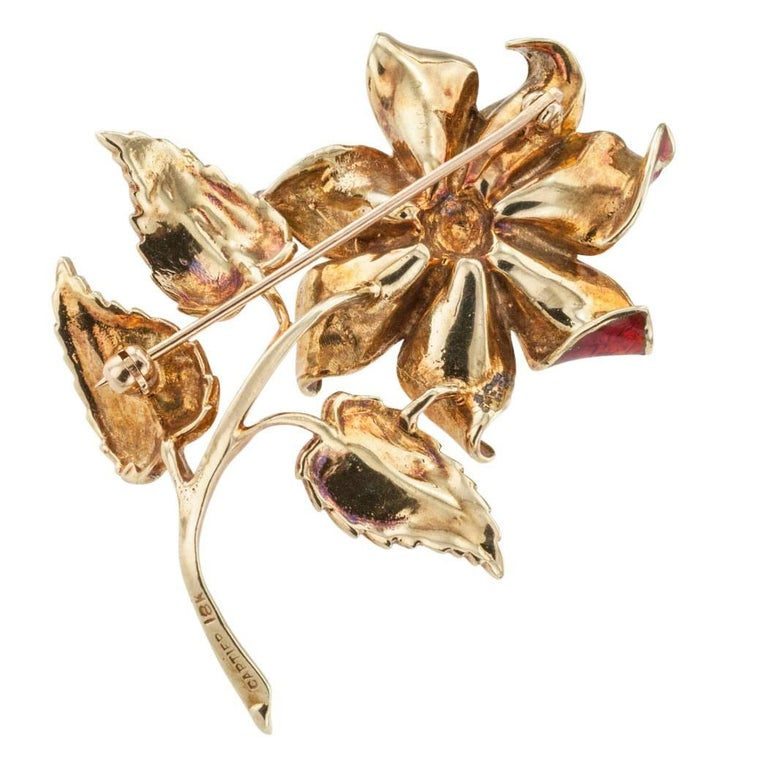 Cartier 1970s Enamel Diamond Flower Brooch  Cartier 1970s diamond enamel and gold brooch.  The single stem flower design centers upon a round brilliant-cut diamond weighing approximately 0.10 carat, approximately G color and VS clarity, mounted in