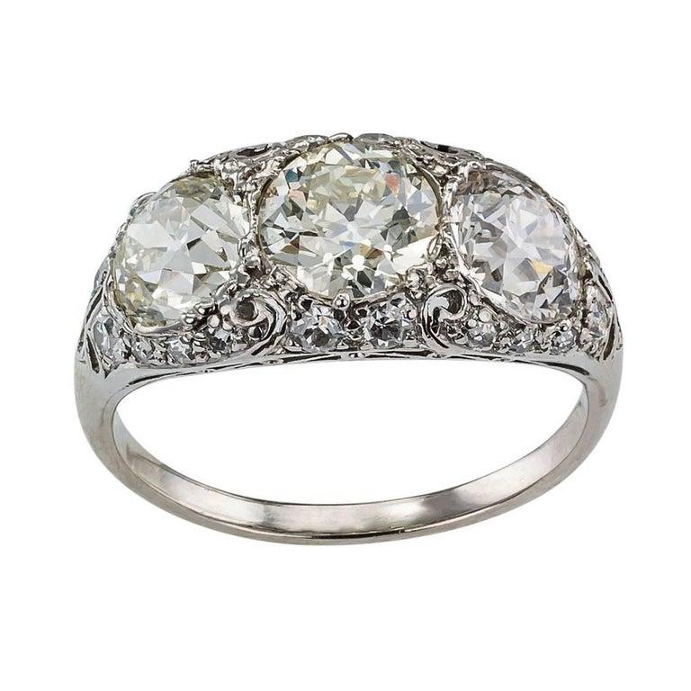 Edwardian Old European Cut Three-Stone Diamond Platinum Ring
