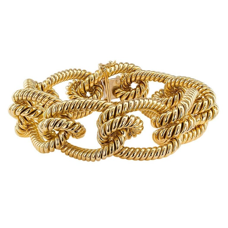Gold knotted rope bracelet circa 1970. Designed as a bright 18-karat yellow gold rope tied in a series of large open knots, this is a chunky-gold-bracelet-lover's dream come true. Definitely makes a statement with its colossal size and unique