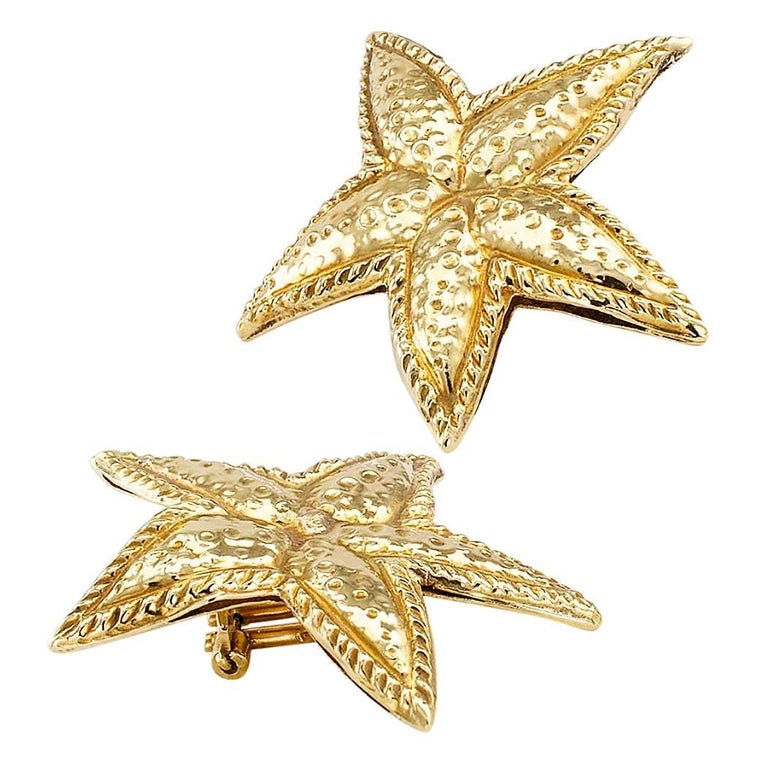 Sea star gold ear clips circa 1980. Sculpted and slightly free-form, these sea star ear clips are handcrafted in luminous 18-karat yellow gold with a bright polish, embellished with embossed textures mimicking the markings on starfish. It is
