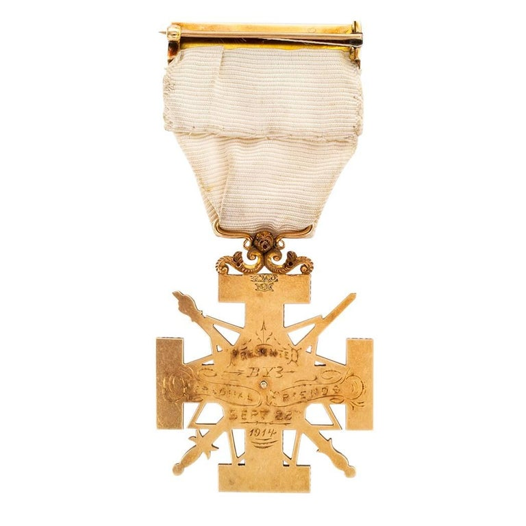 Masonic Scottish Rite 33rd degree commemorative enamel and gold medal dated 1914. The custom made 14-karat gold Scottish Rite jewel is lavishly decorated on the front with Masonic symbology enhanced with red, white and blue enamel, the back engraved