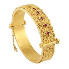 Victorian 1870s Etruscan Revival Ruby Gold Hinged Bangle