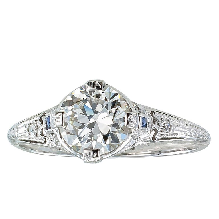 Art Deco 0.96 carat transitional cut diamond and platinum engagement ring circa 1920.  Centering upon a 0.96 carat transitional-cut diamond accompanied by a report from EGL-USA stating that the diamond is H color and VS2 clarity, on an early Art