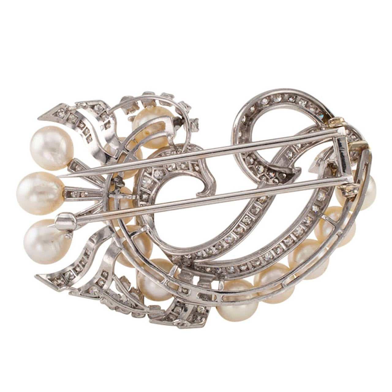 A Mid 20th Century Cultured Pearl And Diamond Clip Brooch Circa 1950  Mid 20th century pearl diamond and platinum clip brooch circa 1950.  The design punctuates the elegance and flair of the period when it was made without being dated.  A luxurious